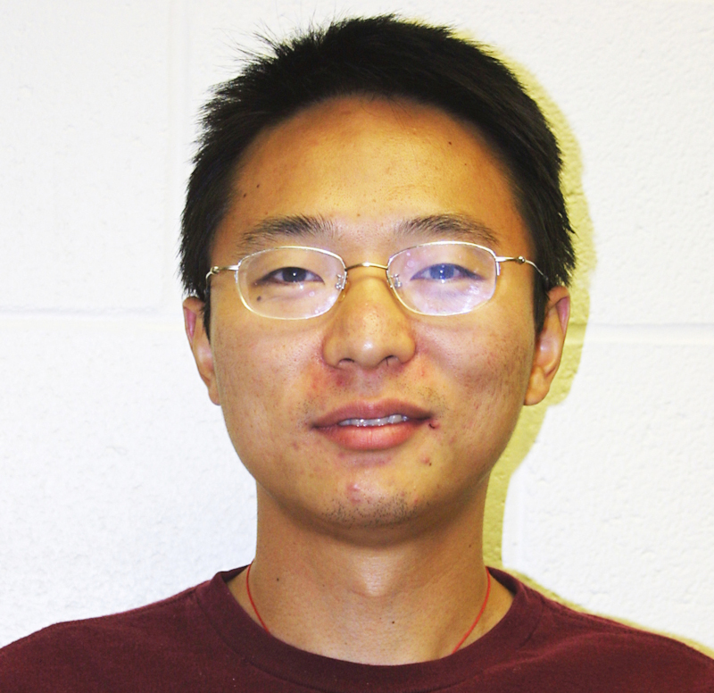 Portrait of Jian-Yang Li, wearing a dark red t-shirt